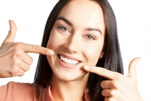 Woman with a beautiful smile from her cosmetic dentist in Inwood Village.